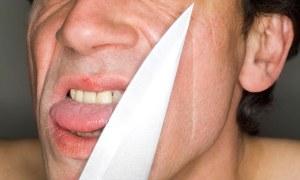 Man holding knife, close-up, portrait